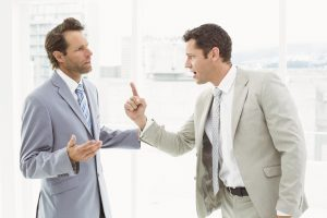 Business male colleagues in an argument at office